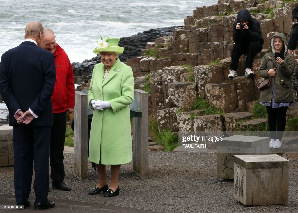 Britain's Queen Elizabeth II (3L) and Britain's Prince Philip, Duke of Edinburgh are shown Giant's causeway, a world heritage site near Bushmills in Northern Ireland during a two-day visit on June 28, 2016. FAITH