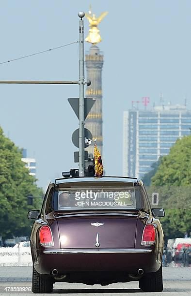 Britain's Queen Elizabeth II and Britain's Prince Philip Duke of Edinburgh drive through Berlin's landmark Brandenburg Gate in a car on June 26 as...