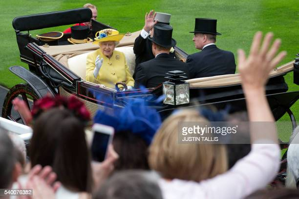 Britain's Queen Elizabeth II and Britain's Prince Philip Duke of Edinburgh arrive for the first day of the Royal Ascot horse racing meet in Ascot...