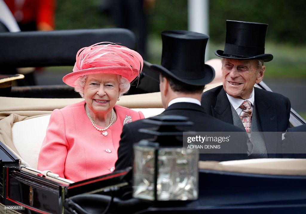 Britain's Queen Elizabeth II and Britain's Prince Philip Duke of Edinburgh arrives in the parade ring for day four at Royal Ascot horse racing meet...