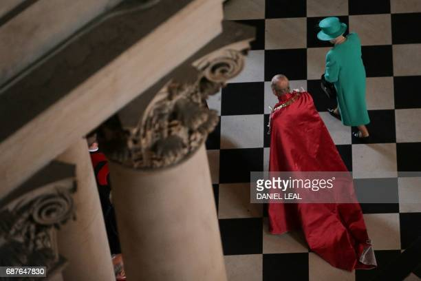 Britain's Queen Elizabeth II and Britain's Prince Philip Duke of Edinburgh leave after a service to mark the Centenary of the Order of the British...