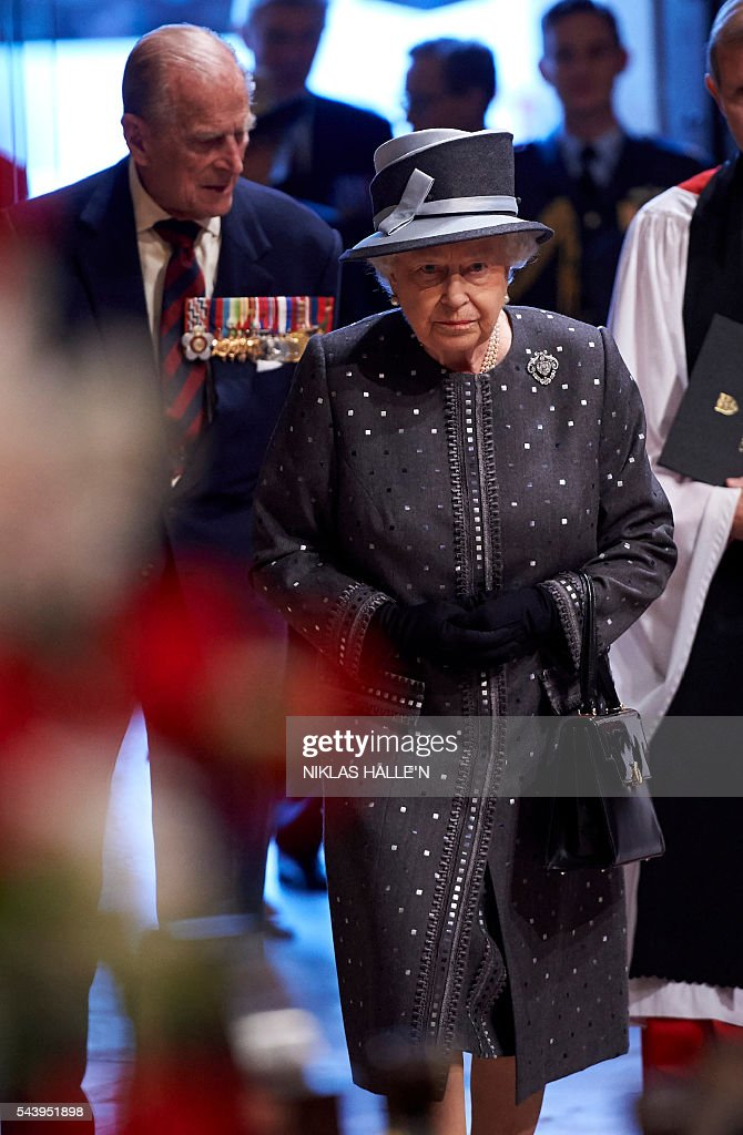 Britain's Queen Elizabeth II and Britain's Prince Philip, Duke of Edinburgh (L) arrive to attend a Service on the Eve of the Centenary of the Battle of the Somme at Westminster Abbey in London on June 30, 2016. Westminster Abbey is holding a Service on the Eve of the Centenary on June 30 2016, and an Overnight Vigil the first time the Abbey has been open all night for a vigil since peace vigils for the Cuban Missile Crisis over fifty years ago. The Abbey service and vigil are part of a programme of centenary events which includes vigils in Scotland, Wales and Northern Ireland, and at Thiepval, Northern France. / AFP / POOL / Niklas HALLE'N