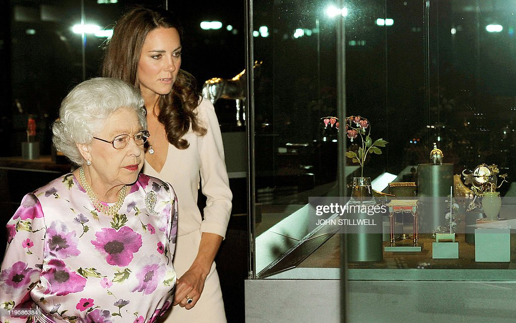 Britain's Queen Elizabeth II (L) and Catherine, the Duchess of Cambridge view a glass cabinet containing part of the Royal Faberge collection at the annual summer exhibition at Buckingham Palace in central London, on July 22, 2011. Britain's Queen Elizabeth II has reportedly described as 'creepy' a new exhibition featuring the wedding dress worn by the former Kate Middleton when she married Prince William in April. The Alexander McQueen dress is being exhibited on a headless mannequin in the ballroom at Buckingham Palace, with the tiara and veil that the now Duchess of Cambridge wore, suspended above it.