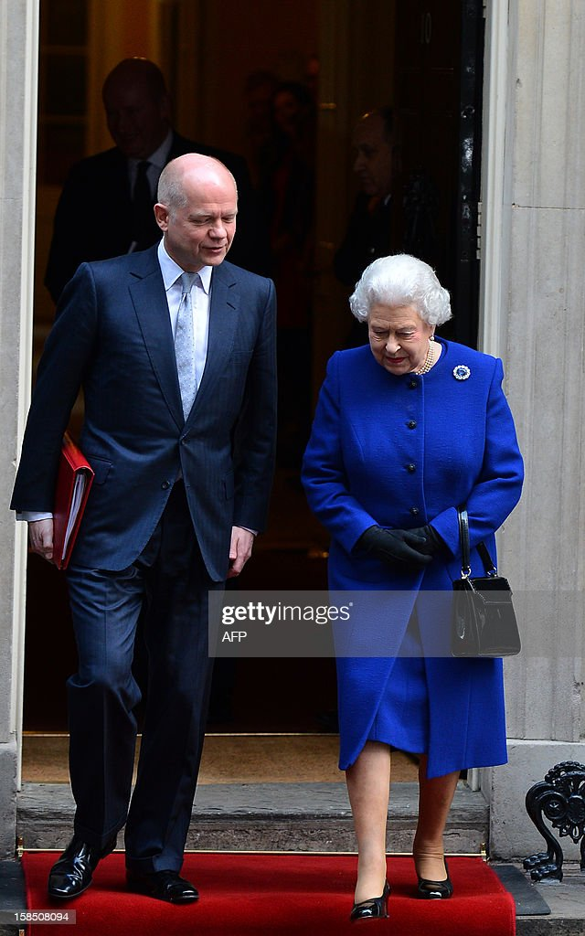 Britain's Queen Elizabeth II (R) and Foreign Secretary William Hague (L) leave no 10 Downing Street in London December 18, 2012 after the monarch sat in as an observer during a meeting of the Cabinet. Queen Elizabeth II attended her first-ever cabinet meeting on Tuesday to mark her diamond jubilee, the only monarch to do so since 1781.The 86-year-old sovereign sat in as an observer on the meeting and received a gift from the Cabinet to celebrate her 60 years on the throne. AFP PHOTO / BEN STANSALL