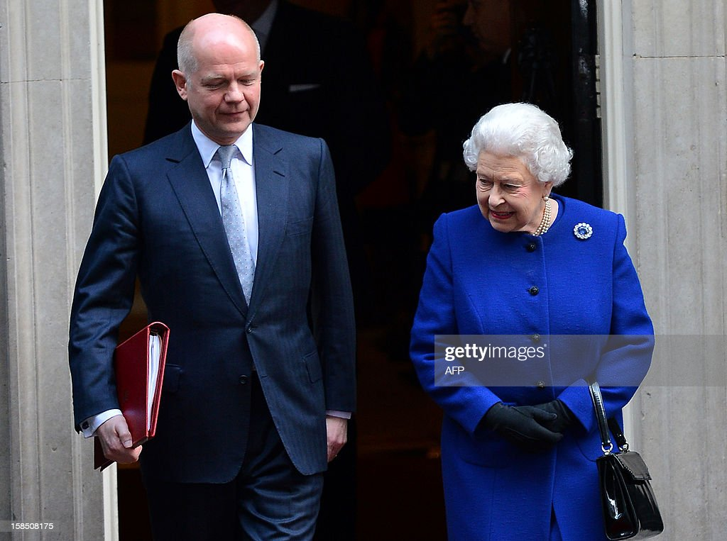 Britain's Queen Elizabeth II (R) and Foreign Secretary William Hague (L) depart no 10 Downing Street in London December 18, 2012 after the monarch sat in as an observer during a meeting of the Cabinet. Queen Elizabeth II attended her first-ever cabinet meeting on Tuesday to mark her diamond jubilee, the only monarch to do so since 1781.The 86-year-old sovereign sat in as an observer on the meeting and received a gift from the Cabinet to celebrate her 60 years on the throne.