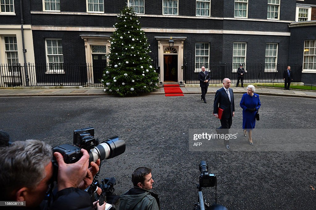 Britain's Queen Elizabeth II (R) and Foreign Secretary William Hague (2R) walk together as they depart no 10 Downing Street in London December 18, 2012 after the monarch sat in as an observer during a meeting of the Cabinet. Queen Elizabeth II attended her first-ever cabinet meeting on Tuesday to mark her diamond jubilee, the only monarch to do so since 1781.The 86-year-old sovereign sat in as an observer on the meeting and received a gift from the Cabinet to celebrate her 60 years on the throne.