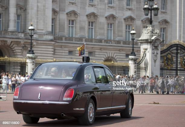 Britain's Queen Elizabeth II and her eldest son Charles The Prince of Wales travel by car from Buckingham Palace to the Houses of Parliament to...