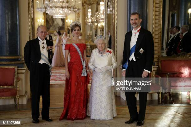 Britain's Queen Elizabeth II and her husband Britain's Prince Philip Duke of Edinburgh pose with Spanish King Felipe VI and his wife Spanish Queen...