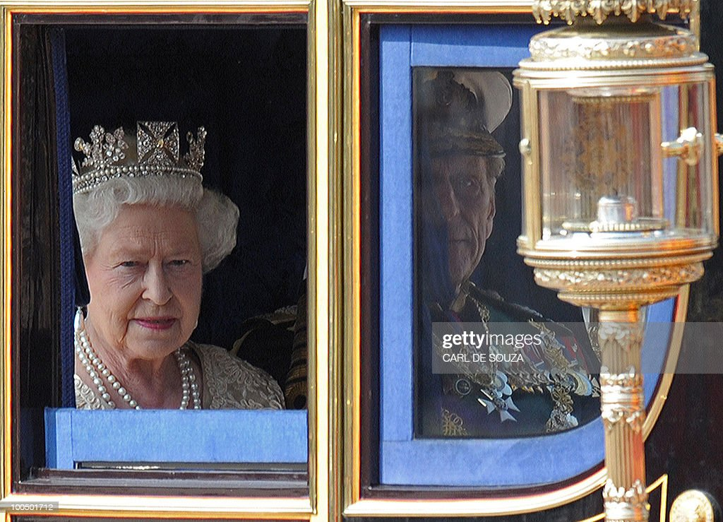 Britain's Queen Elizabeth II and her husband Prince Philip, are driven by horse drawn carriage to the Houses of Parliament, for the State Opening of Parliament, in central London on May 25, 2010. Britain's Queen Elizabeth II set out the new coalition government's legislative programme on Tuesday in a ceremony of pomp and history following the closest general election for decades.