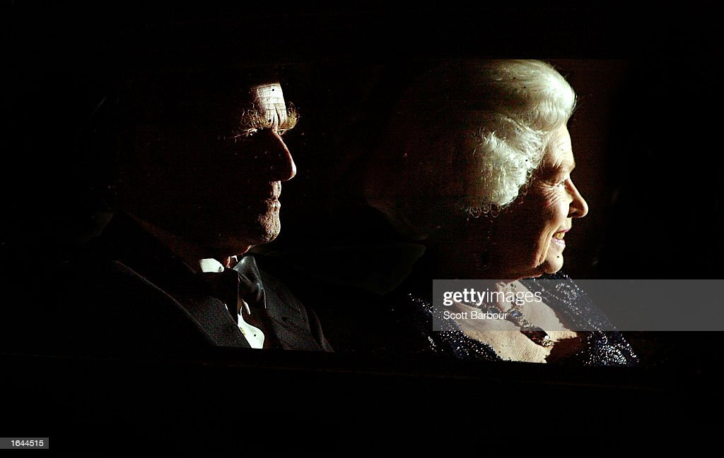Britain's Queen Elizabeth II (R) and her husband Prince Philip leave after attending The Queen's Party of Thanks at the Ritz Hotel November 14, 2002 in London. The Queen hosted the party for close friends and family, thanking them for making her Jubilee year a success. The event was held on Prince Charles's 54th birthday.