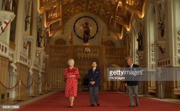 Britain's Queen Elizabeth II and her husband The Duke of Edinburgh escort Crown Prince Naruhito of Japan into the Great Hall in Windsor Castle *...
