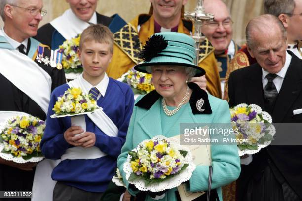 Britain's Queen Elizabeth II and HRH The Duke of Edinburgh stand with clergy and others as they leave Bury St Edmunds Cathedral after attending the...