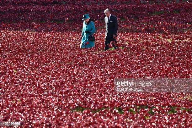 Britain's Queen Elizabeth II and husband Prince Philip Duke of Edinburgh visit the Tower of London's 'Blood Swept Lands and Seas of Red' poppy...