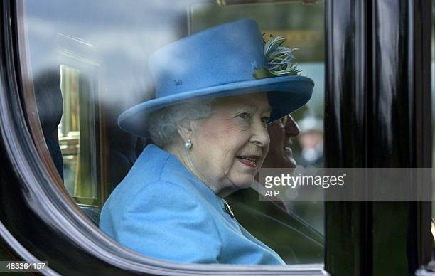 Britain's Queen Elizabeth II and Irish President Michael D Higgins arrive at Windsor Castle in a State Carriage Procession during his state visit in...