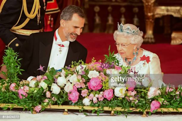 Britain's Queen Elizabeth II and King Felipe VI of Spain attend the State Banquet at Buckingham Palace on July 12 2017 in London England This is the...