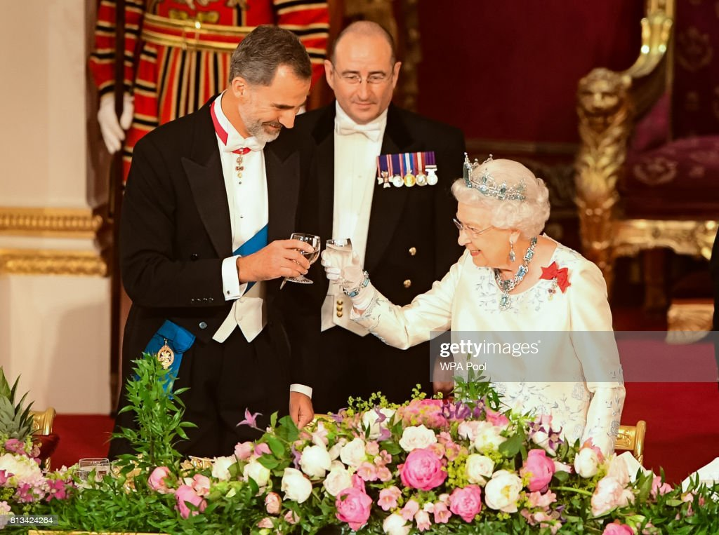 Britain's Queen Elizabeth II, and King Felipe VI of Spain share a toast at the State Banquet at Buckingham Palace on July 12, 2017 in London, England. This is the first state visit by the current King Felipe and Queen Letizia, the last being in 1986 with King Juan Carlos and Queen Sofia.