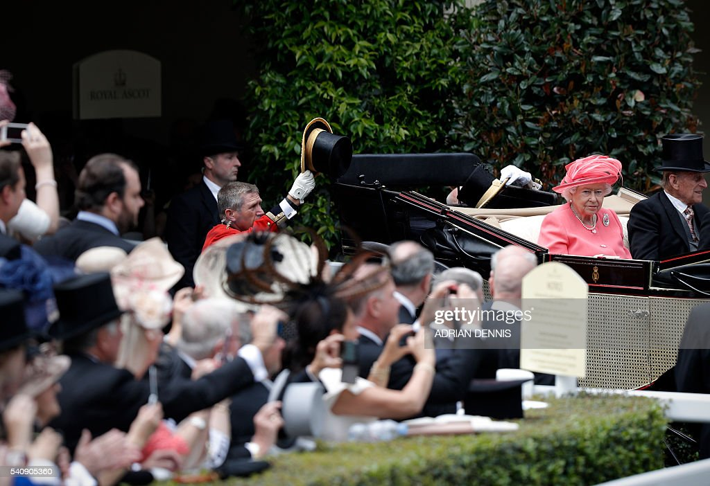 Britain's Queen Elizabeth II and prince Britain's Prince Philip Duke of Edinburgh arrives in the parade ring for day four at Royal Ascot horse racing...