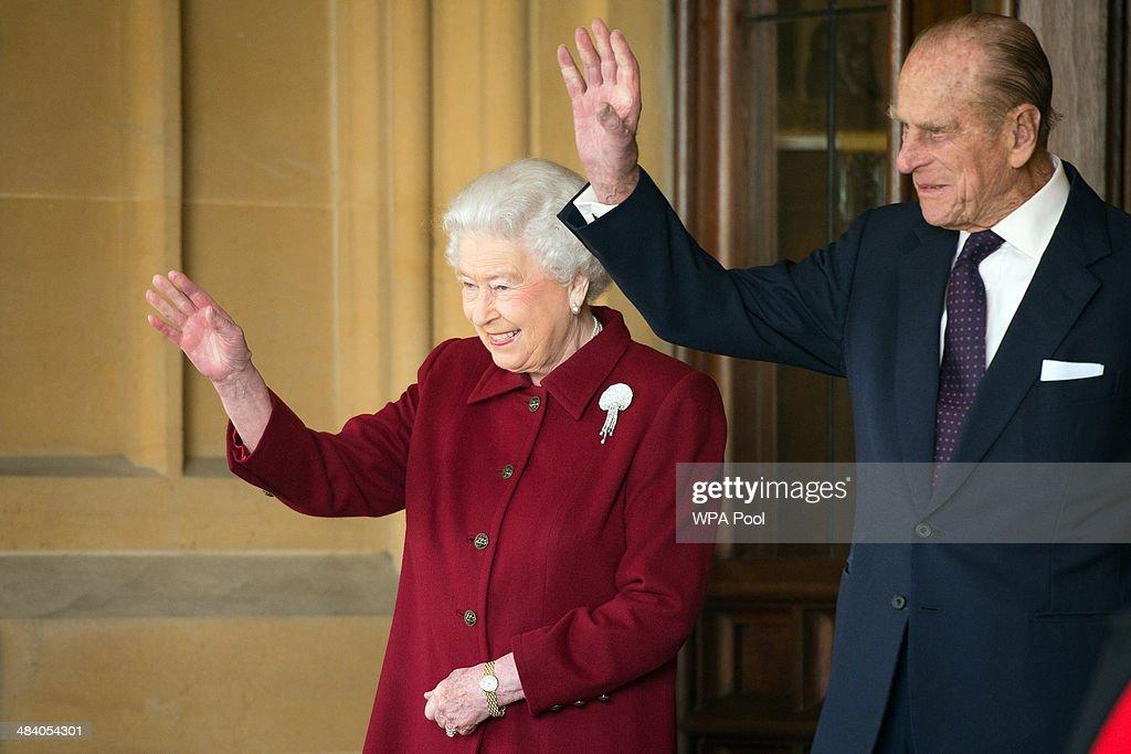 Britain's Queen Elizabeth II and Prince Philip Duke of Edinburgh bid farewell to Irish President Michael D Higgins and his wife Sabina at the end of...