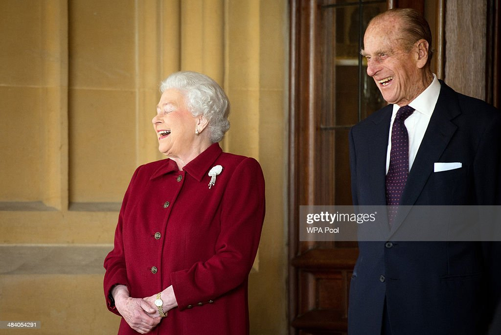 Britain's Queen <a gi-track='captionPersonalityLinkClicked' href=/galleries/search?phrase=Elizabeth+II&family=editorial&specificpeople=67226 ng-click='$event.stopPropagation()'>Elizabeth II</a> and <a gi-track='captionPersonalityLinkClicked' href=/galleries/search?phrase=Prince+Philip&family=editorial&specificpeople=92394 ng-click='$event.stopPropagation()'>Prince Philip</a>, Duke of Edinburgh react as they bid farewell to Irish President Michael D. Higgins and his wife Sabina (not pictured) at the end of their official visit at Windsor Castle on April 11, 2014 in Windsor, United Kingdom. Ireland's Michael D. Higgins is making the first state visit by a president of the republic since it gained independence from neighbouring Britain. The visit comes three years after Queen <a gi-track='captionPersonalityLinkClicked' href=/galleries/search?phrase=Elizabeth+II&family=editorial&specificpeople=67226 ng-click='$event.stopPropagation()'>Elizabeth II</a> made a groundbreaking trip to the republic, which helped to heal deep-rooted unease and put British-Irish relations on a new footing.