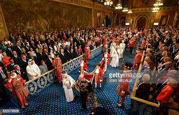 TOPSHOT Britain's Queen Elizabeth II and Prince Philip Duke of Edinburgh proceed through the Royal Gallery in the Houses of Parliament as they attend...