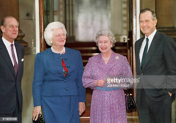 Britain's Queen Elizabeth II and Prince Philip pose with former US President George Bush and his wife Barbara 30 November 1993 after Bush had been...