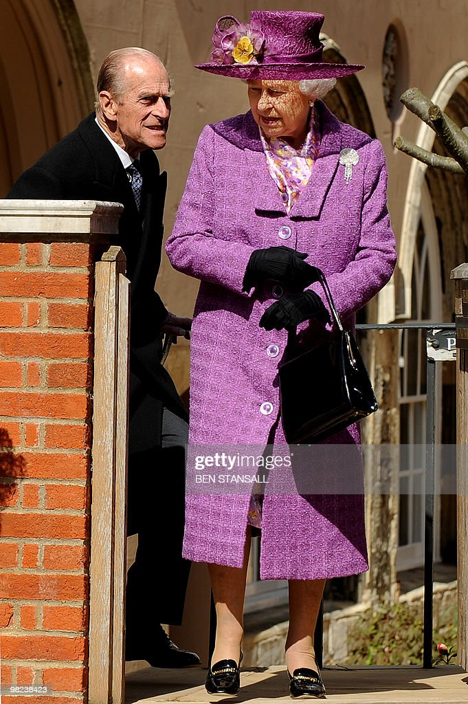 Britain's Queen Elizabeth II (R) and Prince Philip, the Duke of Edinburgh (L) leave after attending an Easter Sunday church service in Windsor on April 4, 2019.