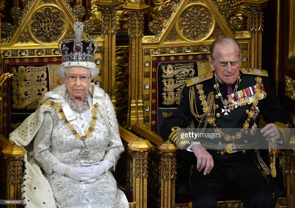 Britain's Queen Elizabeth II and Prince Phillip, Duke of Edinburgh (R) attend the State Opening of Parliament on May 8, 2013 in London, England. Queen Elizabeth II unveiled the coalition government's legislative programme in a speech delivered to Members of Parliament and Peers in The House of Lords. Proposed legislation is expected to be introduced on toughening immigration regulations, capping social care costs in England and setting a single state pension rate of 144 GBP per week.