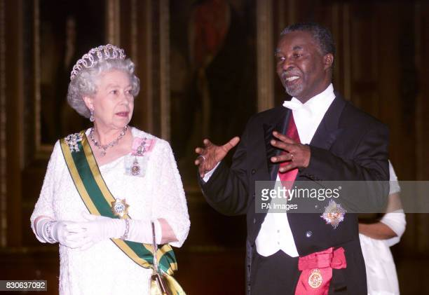 Britain's Queen Elizabeth II and South African President Thabo Mbeki walk towards the state banquet in St George's Hall at Windsor Castle Berkshire...