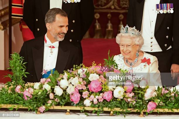 Britain's Queen Elizabeth II and Spanish King Felipe VI chat during a State Banquet at Buckingham Palace in central London on July 12 on the first...