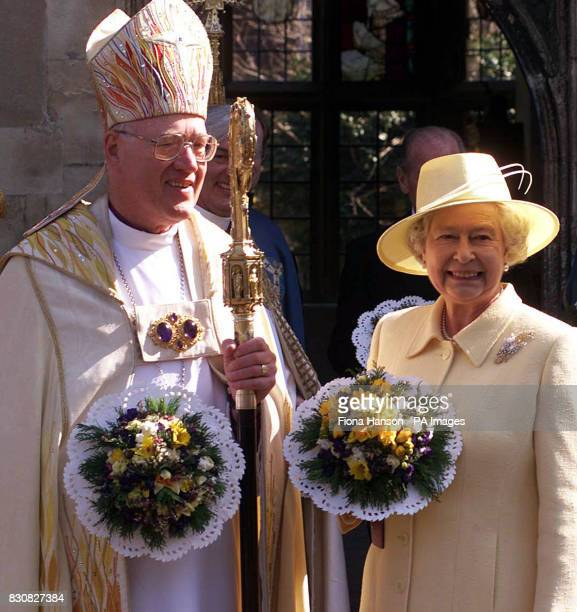 Britain's Queen Elizabeth II and the Archbishop of Canterbury Doctor George Carey stand outside the Deanery at Canterbury Cathedral after attending a...