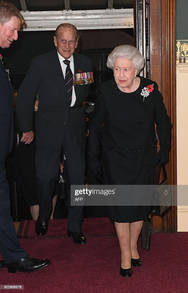 Britain's Queen Elizabeth II and the Britain's Prince Philip, Duke of Edinburgh (C) arrive at the Royal Albert Hall for the annual Royal Festival of Remembrance in central London on November 12, 2016. This year's Festival will mark the following anniversaries: the centenaries of the Battle of the Somme and the Battle of Jutland, the 25th anniversary of the Gulf War and the and the 80th anniversary of the first flight of the Supermarine Spitfire. / AFP / POOL / Victoria Jones