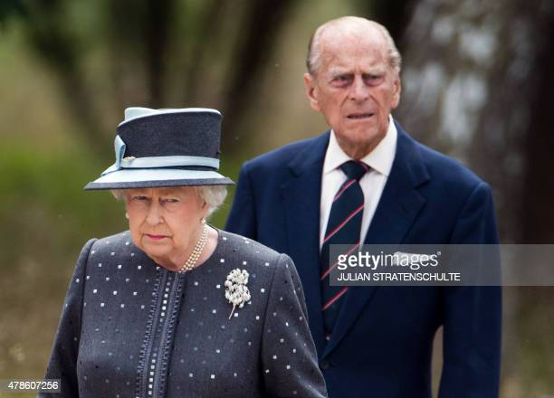 Britain's Queen Elizabeth II and The Duke of Edinburg Prince Philip visit the memorial site of former Nazi concentration camp BergenBelsen on June 26...