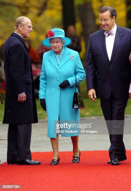 Britain's Queen Elizabeth II and the Duke of Edinburgh are received by the President of Estonia Toomas Hendrick Ilves on their arrival at the...