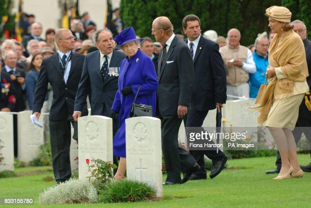 Britain's Queen Elizabeth II and the Duke of Edinburgh followed Queen Paola of Belgium visit the Tyne Cot War Cemetery Passchendaele for WWI...