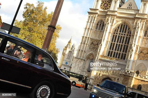 Britain's Queen Elizabeth II and the Duke of Edinburgh leave Westminster Abbey in London after formally opening the General Synod of the Church of...