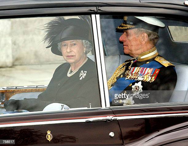 Britain's Queen Elizabeth II and the Duke of Edinburgh leave Westminster Abbey after the funeral of the Queen Mother April 9 2002 in London The...