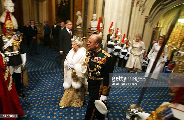 Britain's Queen Elizabeth II and the Duke of Edinburgh leave from the Sovereign's Entrance of the House of Lords after she delivered the Queen's...