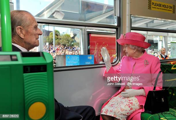 Britain's Queen Elizabeth II and the Duke of Edinburgh ride on an electric tram through the Melbourne city centre past huge crowds of well wishers in...
