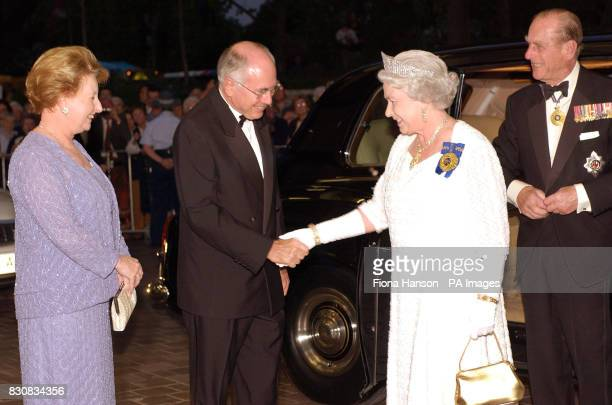 Britain's Queen Elizabeth II and the Duke of Edinburgh right are greeted by Australian Prime Minister John Howard and his wife Janette left for a...