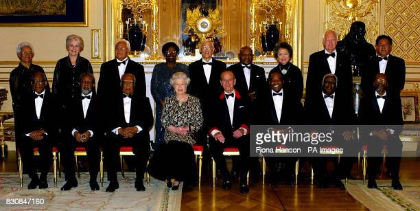 Britain's Queen Elizabeth II and The Duke of Edinburgh sit with 15 GovernorsGeneral of the Commonwealth before attending dinner to mark their first...