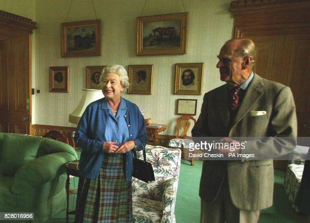 Britain's Queen Elizabeth II and the Duke of Edinburgh wait to receive the President of Malta Dr Edward FenechAdami and his wife Mary at Balmoral...