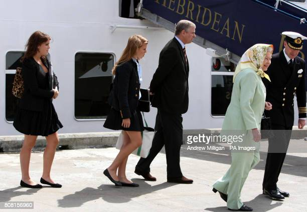 Britain's Queen Elizabeth II and the Duke of York with Princess Eugenie and Princess Beatrice board the Hebridean Princess in Stornoway with Captain...