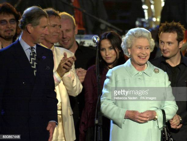 Britain's Queen Elizabeth II and The prince of Wales on stage in the gardens of Buckingham Palace for the second concert to commemorate the Golden...