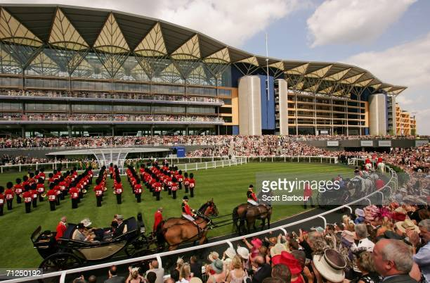 Britain's Queen Elizabeth II arives in a horse drawn carriage to officially open the new grandstand on first day of Royal Ascot at the Ascot...