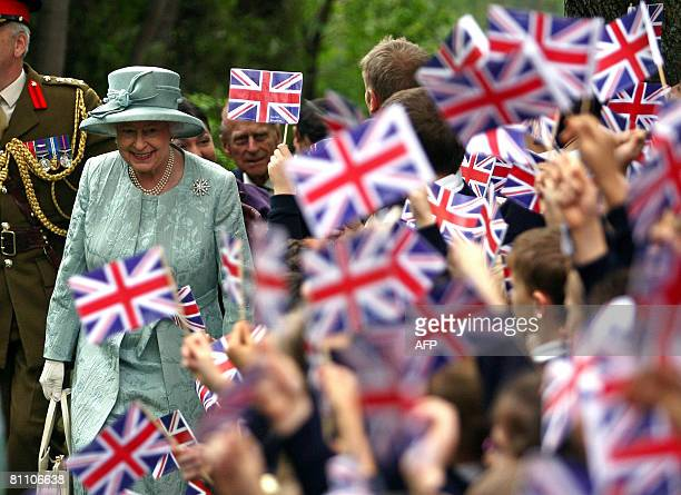 Britain's Queen Elizabeth II arrives at the British Embassy as children wave flags in Ankara on May 16 2008 Queen Elizabeth II wrapped up a fourday...
