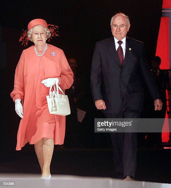 Britains Queen Elizabeth II arrives at the opening of the Commonwealth Heads of Government Meeting with Australian Prime Minister John Howard March 2...