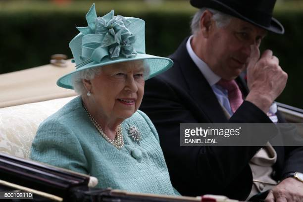 Britain's Queen Elizabeth II arrives by carriage on the fourth day of the Royal Ascot horse racing meet in Ascot west of London on June 23 2017 The...