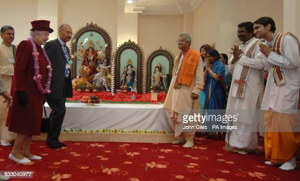 Britain's Queen Elizabeth II arrives for a visit to a hindu temple in Bradford today