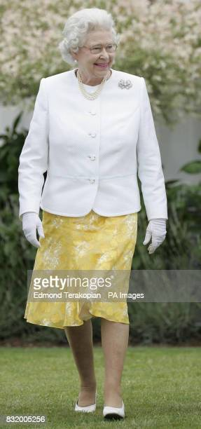 Britain's Queen Elizabeth II arrives to make presentations to the teams following the Queen's Cup Final at the Guards Polo Club Windsor Great Park