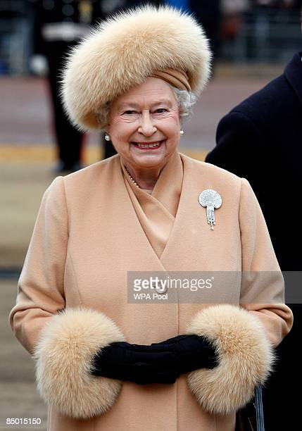 Britain's Queen Elizabeth II arrives to unveil a memorial to Queen Elizabeth the Queen Mother on the Mall on February 24 2009 in London England The...